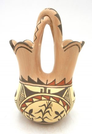 Jemez handmade buff polished and painted wedding vase with twisted handle by Juanita Fragua
