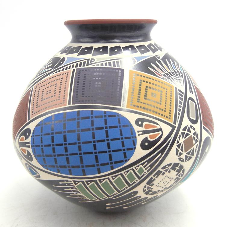 Mata Ortiz multi-color and multi-design small jar by Oscar Quezada