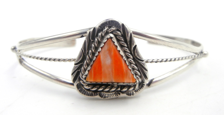 Navajo small triangular orange spiny oyser shell and sterling silver cuff bracelet