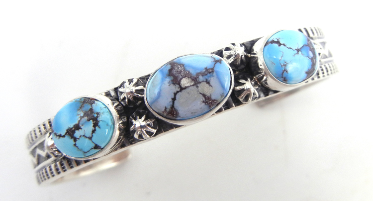 Navajo Golden HIlls turquoise and sterling silver row cuff bracelet by June Defauito