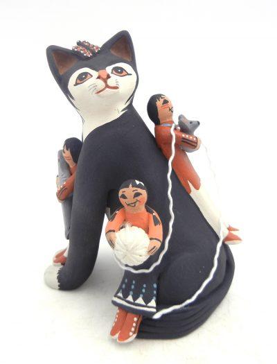 Jemez black cat storyteller with three children by Carol Lucero Gachupin