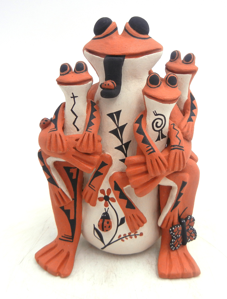 Jemez handmade and hand painted frog storyteller figurine with three froglets by Carol Lucero Gachupin