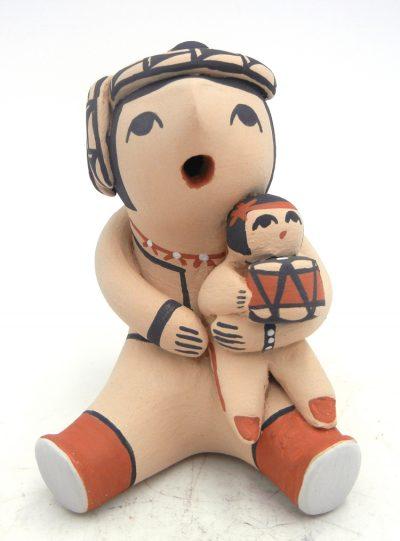 Jemez seated male storyteller figurine with one child by Melesia Toya