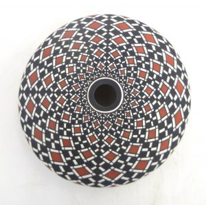Laguna handmade and hand painted polychrome eyedazzler seed pot by Robert Kasero