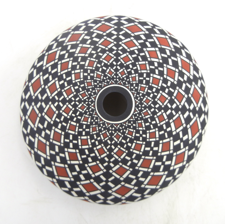 Laguna handmade and hand painted polychrome eyedazzler seed pot by Robert Kasero