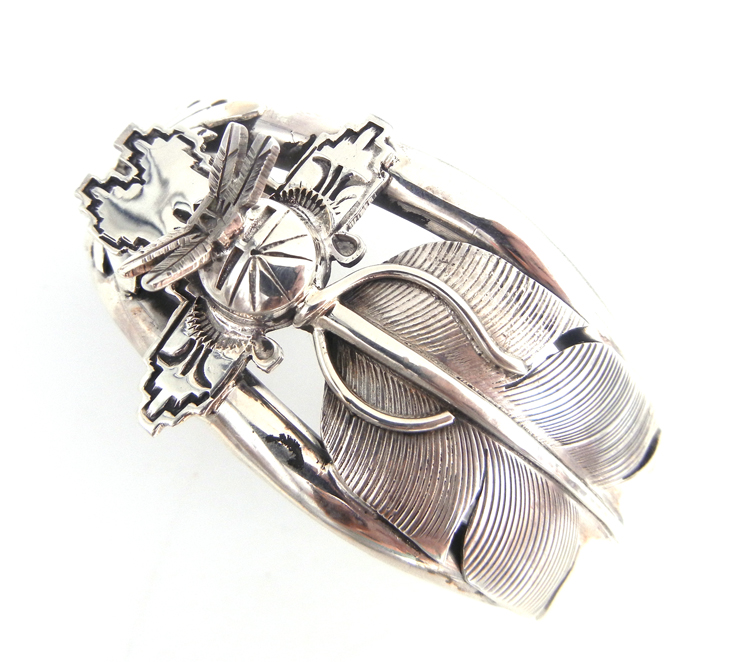 Navajo sterling silver maiden and feather cuff bracelet by Bennie Ration