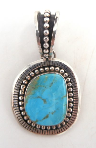 Navajo Turquoise Mountain turquoise and sterling silver pendant by Johnathan Nez