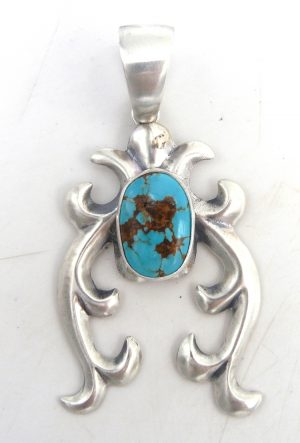 Navajo sandcast sterling silver and turquoise naja pendant