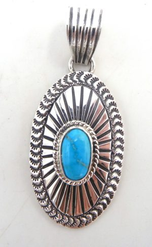 Navajo sterling silver and turquoise concho style pendant