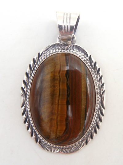 Navajo tiger eye and sterling silver pendant by Will Denetdale