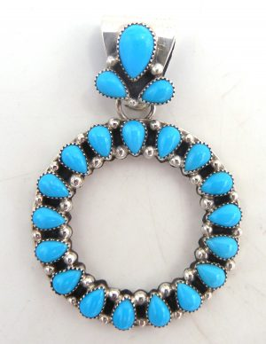 Zuni turquiose and sterling silver cut out circle pendant
