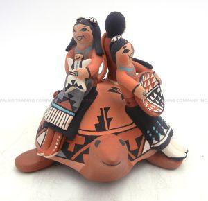 Jemez turtle figurine with three children by Carol Lucero Gachupin