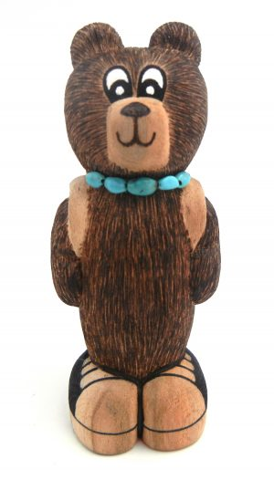 Zuni carved cottonwood bear with sneakers, backpack, and turquoise accents by Elise Westika and Evander Shelendewa