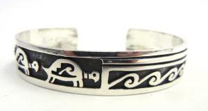 Hopi multi-pattern sterling silver overlay cuff bracelet by Floyd Lomakuyvaya
