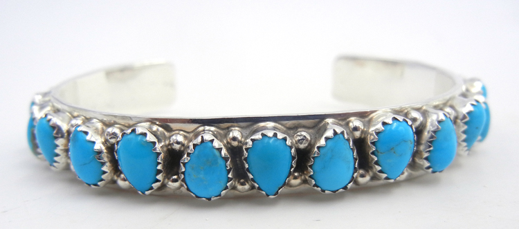 Navajo tear drop shaped turquoise and sterling silver row cuff bracelet