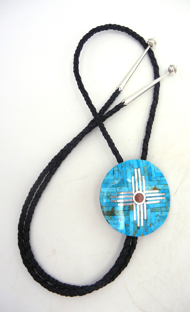 Santo Domingo inlaid turquoise, apple coral, and sterling silver zia symbol bolo tie by Ambrosio Chavez