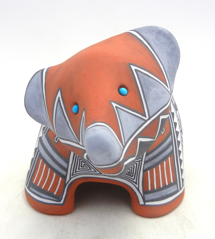 Jemez handmade and hand painted polychrome bear figurine with turquoise accents by Scott Small