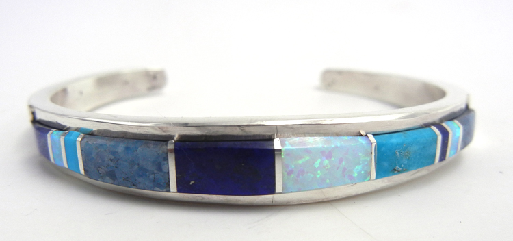 Navajo multi-stone and sterling silver channel inlay cuff bracelet by Kyle Yellowhair
