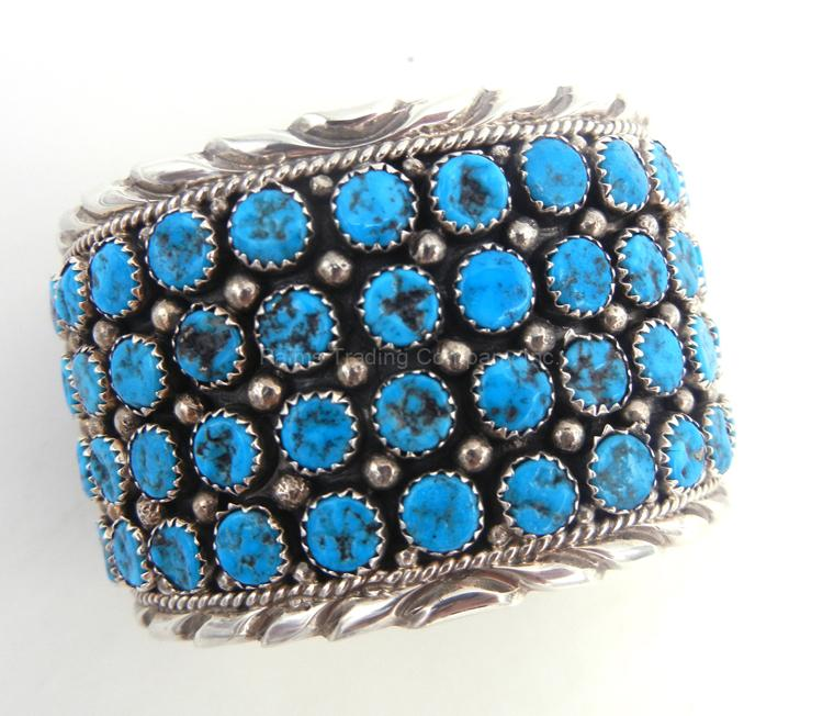 Navajo turquoise nugget and sterling silver wide band row cuff bracelet