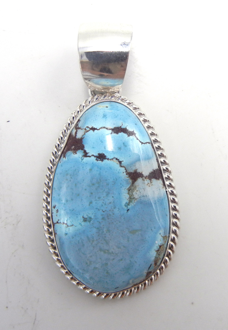 Navajo Golden Hills turquoise and sterling silver pendant