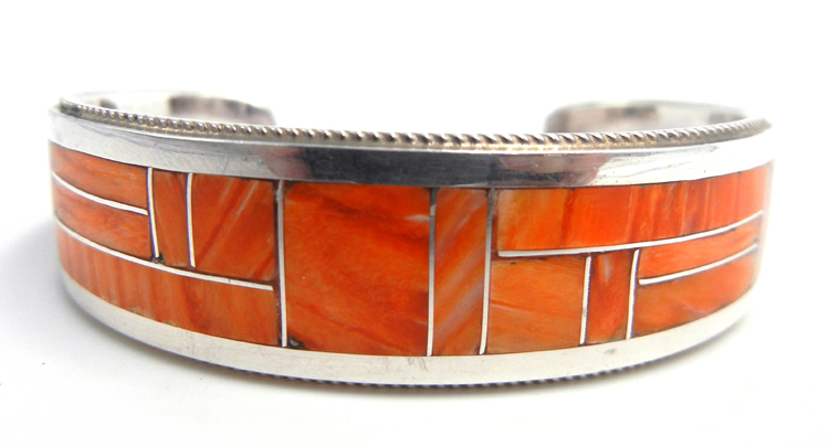 Zuni orange spiny oyster shell and sterling silver channel inlay cuff bracelet by Rickel and Glendora Booqua