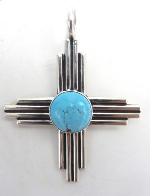 Navajo turquoise and sterling silver Zia symbol pendant