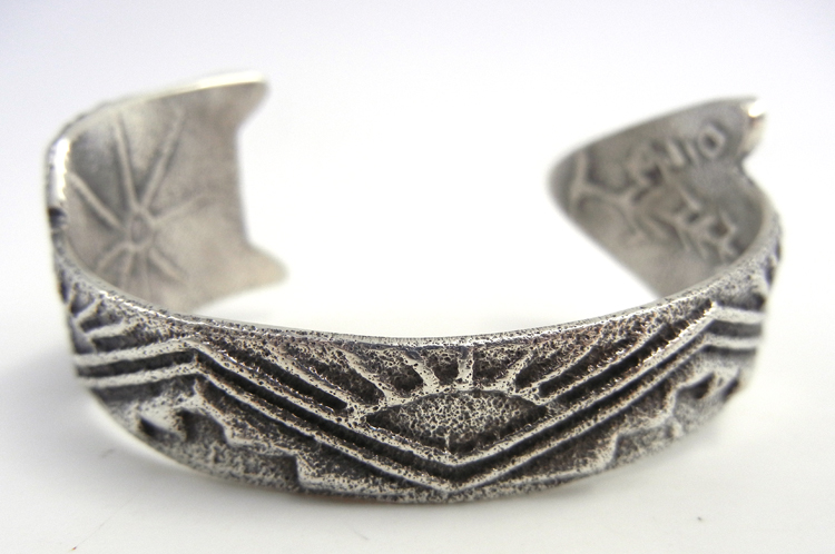 Santo Domingo sterling silver tufa cast arrow cuff bracelet by Gilbert 'Dino' Garcia