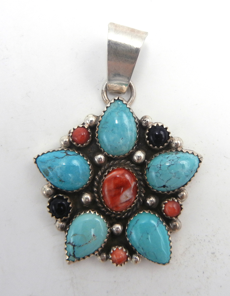 Navajo turquoise, red spiny oyster shell, onyx and sterling silver star pattern pendant