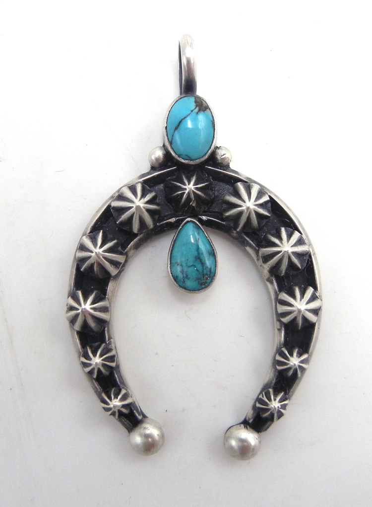 Navajo turquoise and appliqued sterling silver star pattern naja pendant
