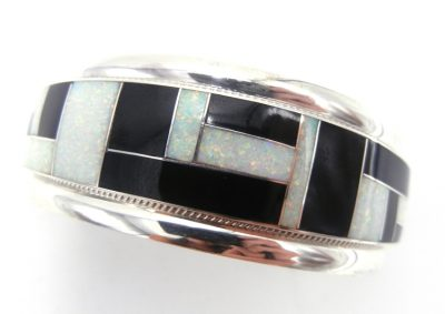 Zuni jet, lab opal, and sterling silver channel inlay cuff bracelet by Rickel and Glendora Booqua