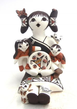 Acoma seated female storyteller with girl, boy, cat, and dog by Judy Lewis