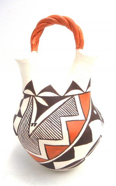 Acoma handmade and hand painted wedding vase with twisted handle by Regina Shutiva