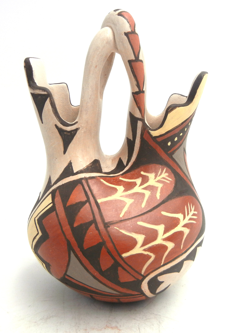 Jemez handmade and hand painted polychrome wedding vase with twisted handle by Juanita Fragua