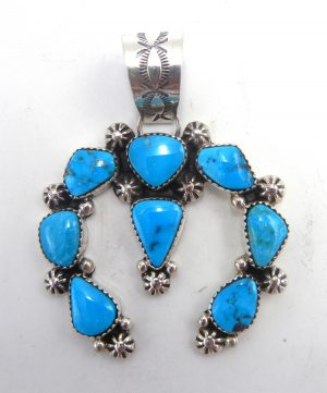 Navajo turquoise and sterling silver naja pendant